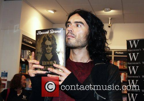 Russell Brand  meets fans and signs copies...