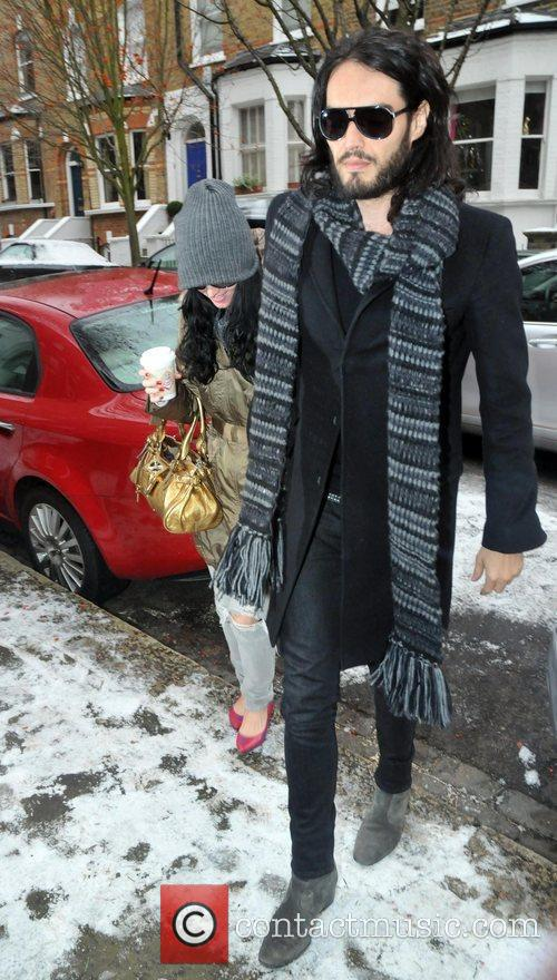 Russell Brand and Katy Perry arrive back at...