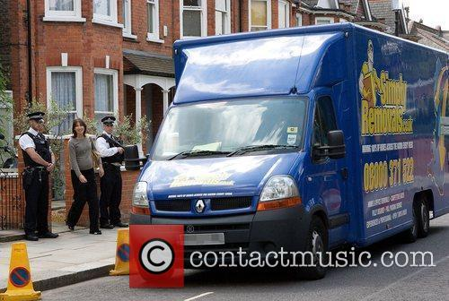 Samantha Cameron leaving her house as removal men...