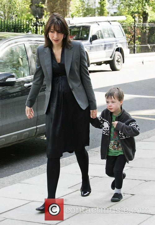 Taking her son Arthur Cameron to school
