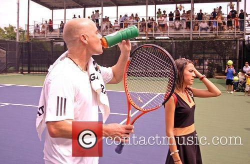 Retired US tennis champions Andre Agassi and Pete...