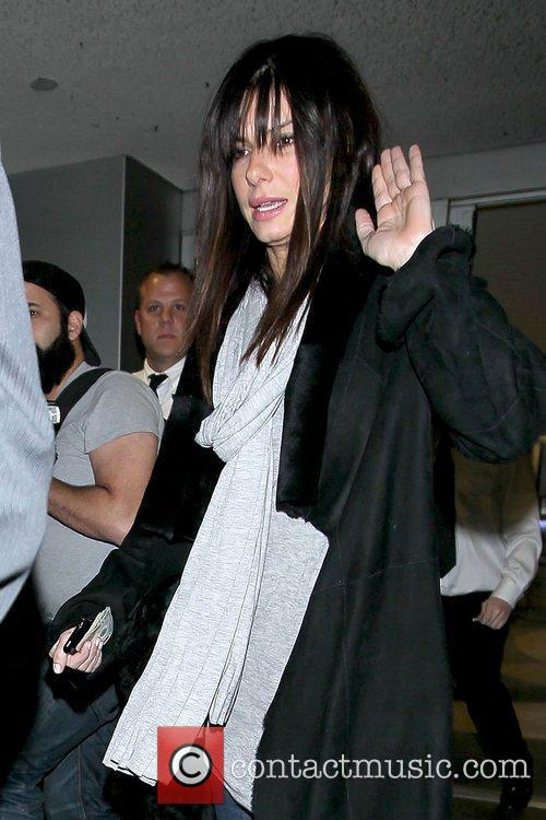 Looking tired as she arrives at LAX airport...