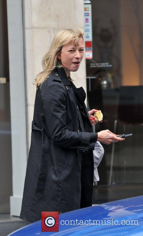 Eating an apple as she leaves the BBC...