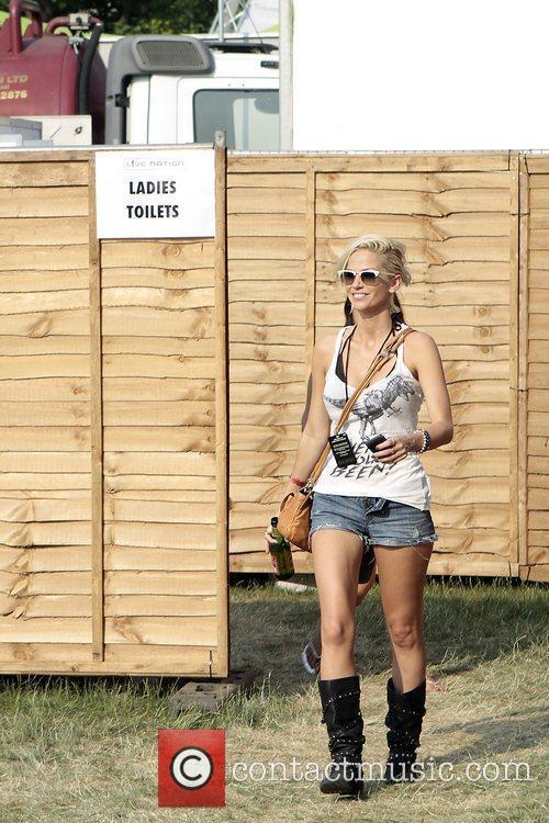 Sarah Harding leaving the ladies toilets backstage Hard...