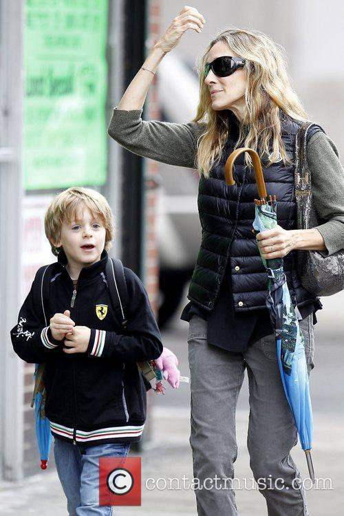 Sarah Jessica Parker walking with her son to...