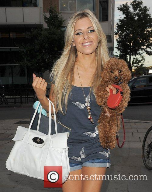 Mollie King from girl group The Saturdays and her pet poodle Alfie, leaving the bands record company head office, having taken part in a live web chat with the rest of the band, as part of their promotional blitz. The group are hoping for their first Number 1 single on Sunday. Mollie asked snappers to make sure they Alfie's good side as they photographed her holding him!