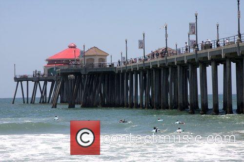 Celebrity Surfers at Huntington Beach Pier participates in...