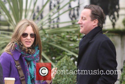 Trinny Woodall and David Cameron stop for a...