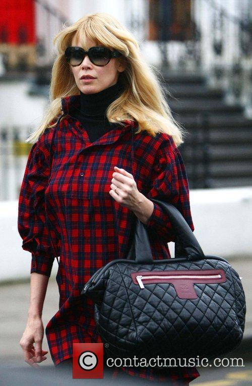 Pregnant Claudia Schiffer dropping her children off at...