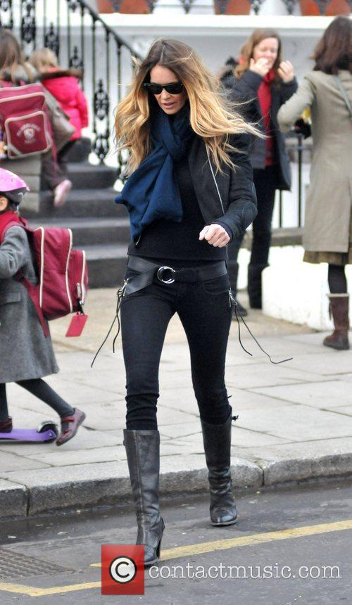 Elle MacPherson takes her child to school