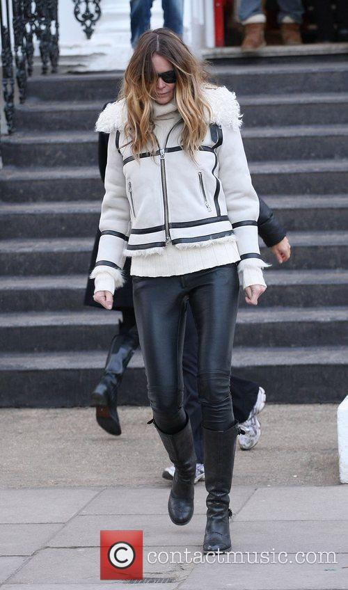 Elle MacPherson returns home after taking her son...