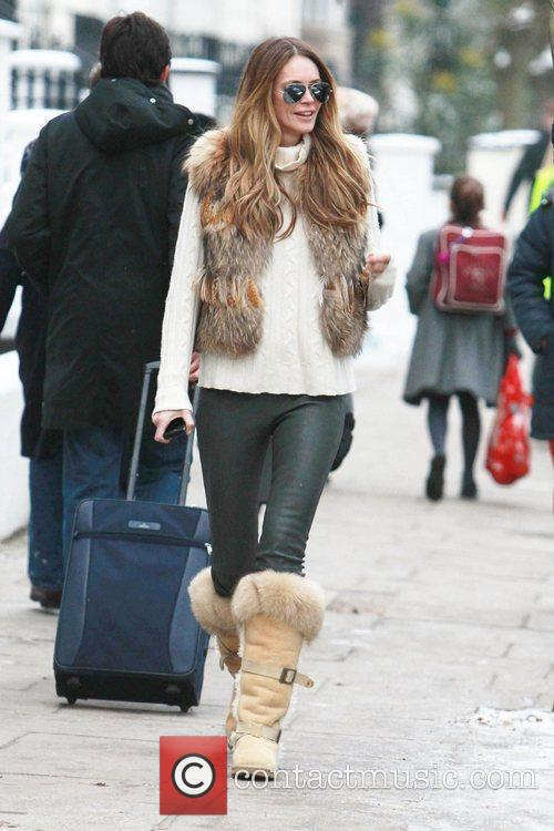 Elle Macpherson  after dropping her children at...