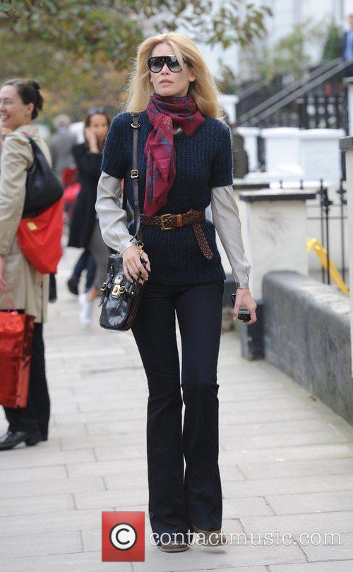 Claudia Schiffer  wearing a scarf and flared...