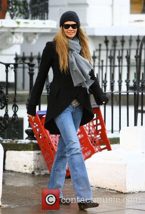 Elle Macpherson after dropping her children to school...