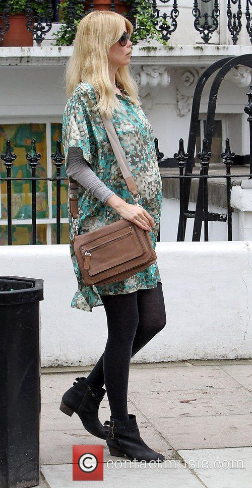 Pregnant Claudia Schiffer after dropping her children off...