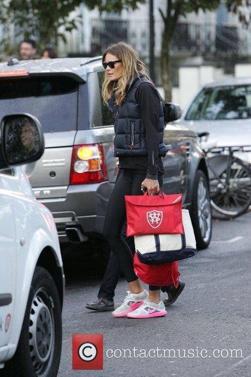 Elle Macpherson walking her son to school London,...