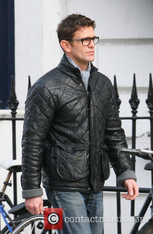 Scott Maslem waking around Primrose Hill wearing glasses...