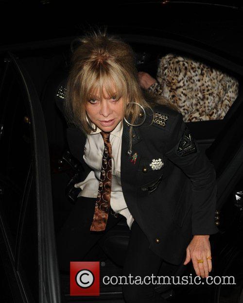 Jo Wood arriving at Scream wearing a shirt...