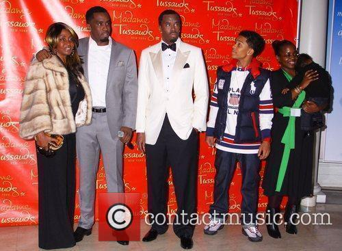 Sean Diddy Combs with his wax figure and...