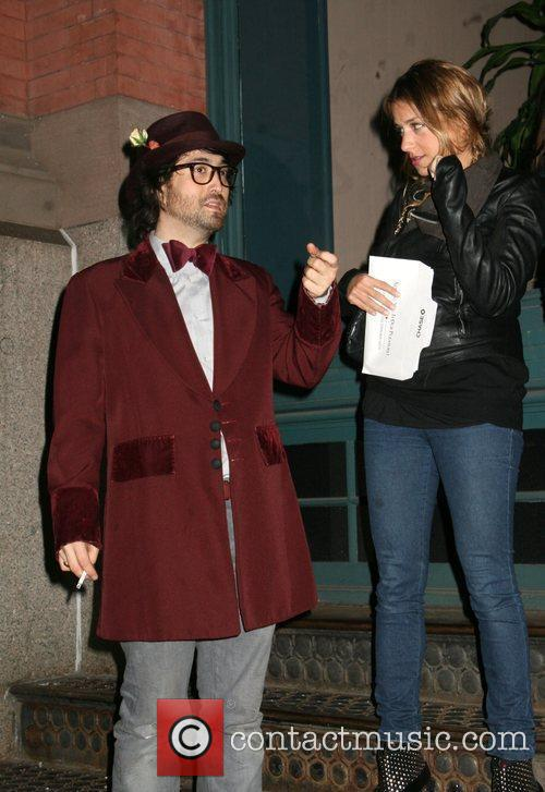 Sean Lennon enjoys a cigarette with Charlotte Ronson...