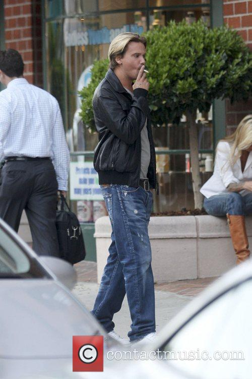 Sean Stewart was spotted smoking a cigarette outside...