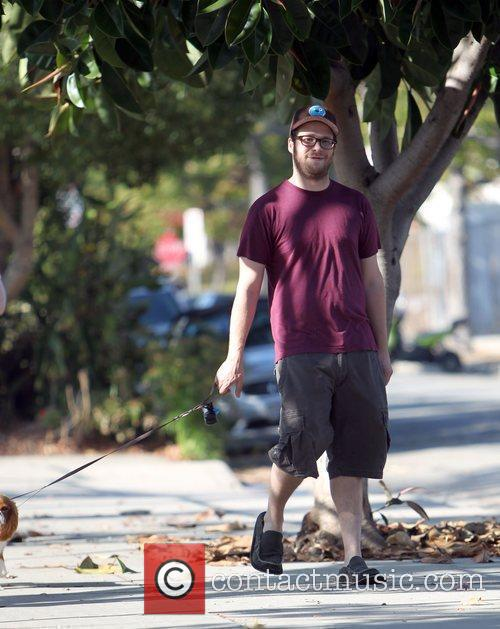 Seth Rogen takes his dog for a walk...