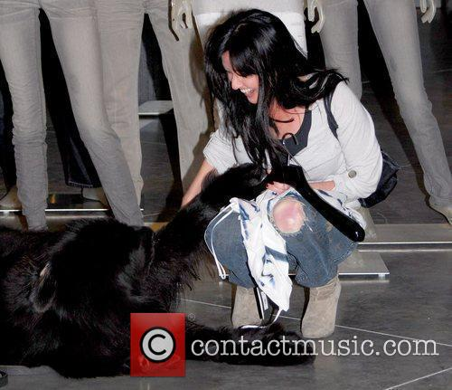 Shannen Doherty petting a dog inside Armani Exchange...