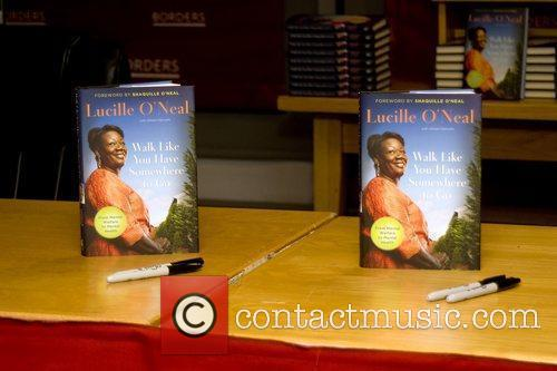 Basketball superstar Shaquille O'Neal's mother, Lucille O'Neal, signs...