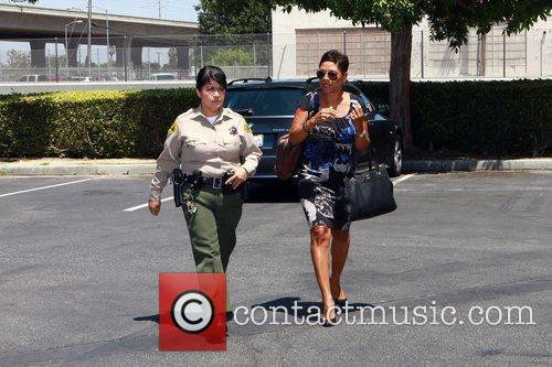 Arrives outside Lynwood Correctional Facility to visit her...