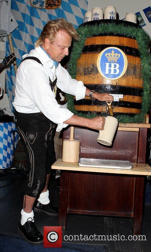 Siegfried Fischbacher taps the keg at Hofbrauhaus Las...