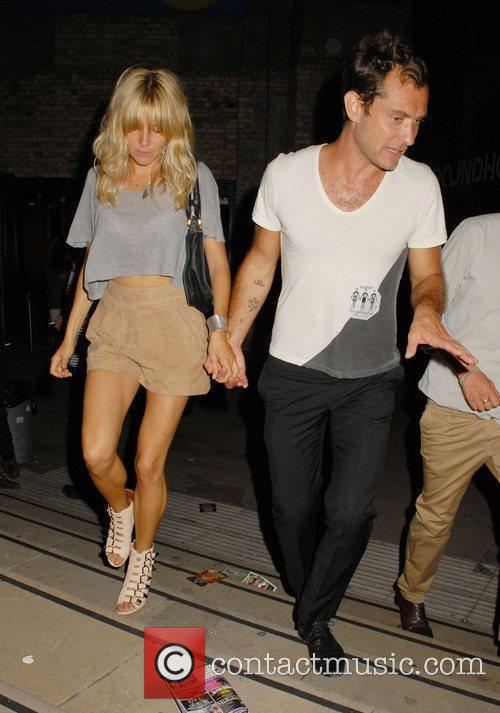 Sienna Miller and Jude Law leaving the The...