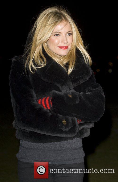Sienna Miller lights the 'London Eye' red for...