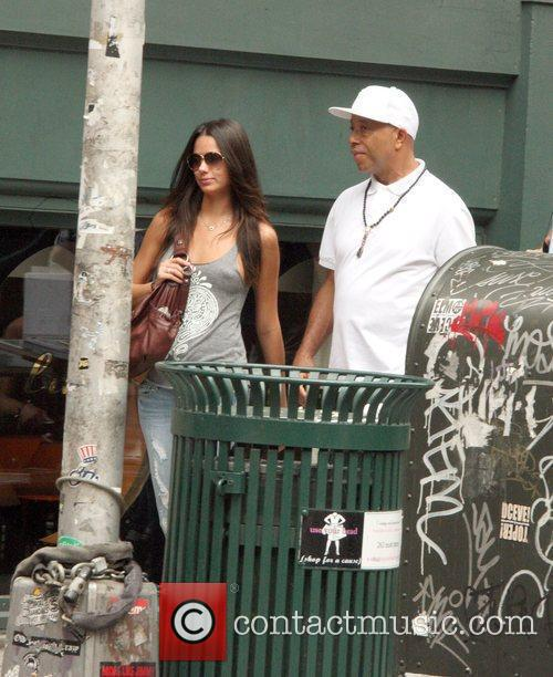 Mogul Russell Simmons with his girlfriend in Soho...