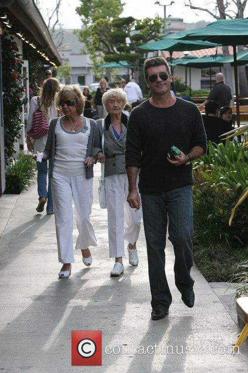 Simon Cowell leaving a restaurant with his mother...