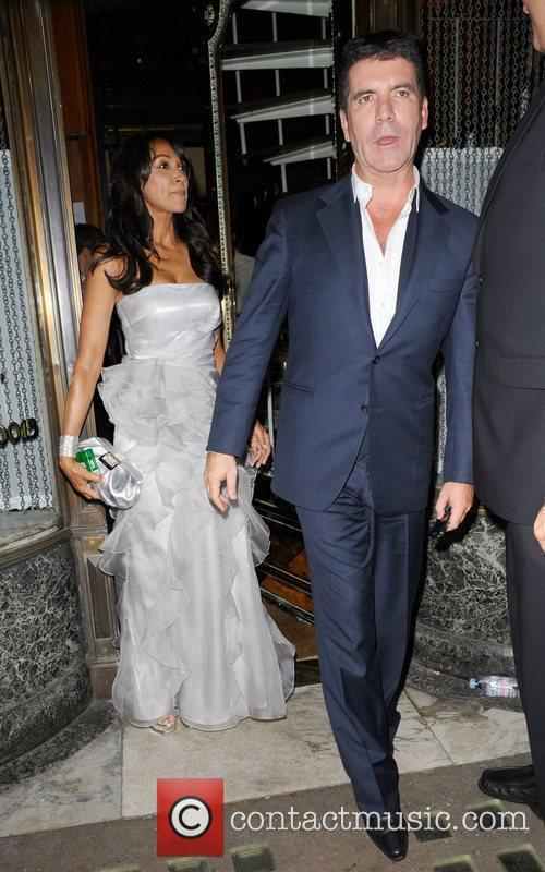 Simon Cowell and a female companion leaving Mr...