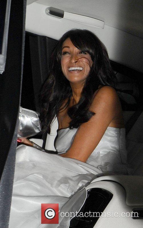 Simon Cowell's female friend leaving Mr Chows restaurant...