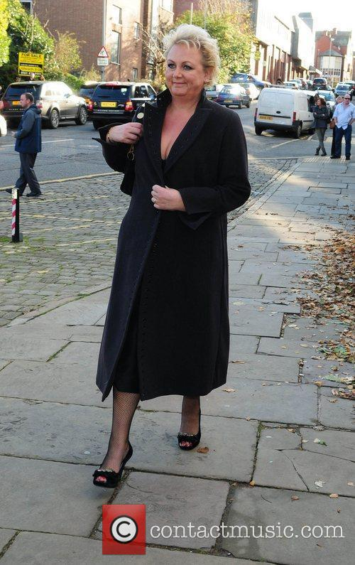 Sue Clever arrives for the wedding of Simon...