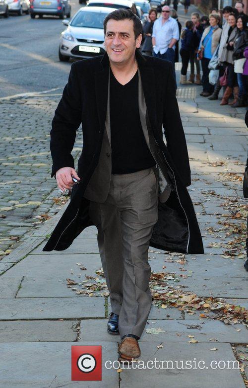 Chris Gascoiyne arrives for the wedding of Simon...