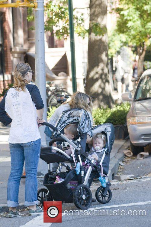Sarah Jessica Parker takes her daughters Marion and...