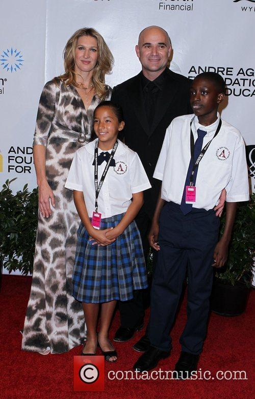 Steffi Graf and Andre Agassi with students Andre...