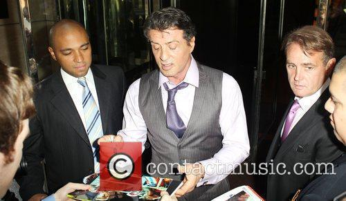 Sylvester Stallone is seen signing autographs for fans...