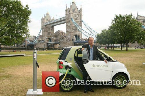 Shows off Smart's new electric car at Tower...
