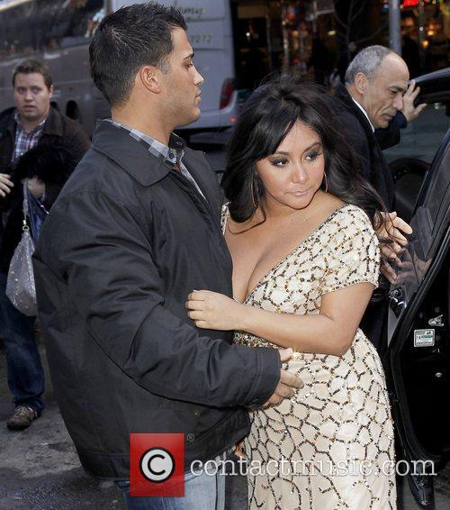Nicole Polizzi aka Snooki getting out of a...