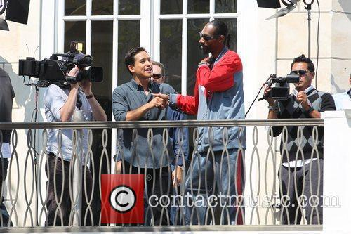 Mario Lopez and Snoop Dogg filming an interview...