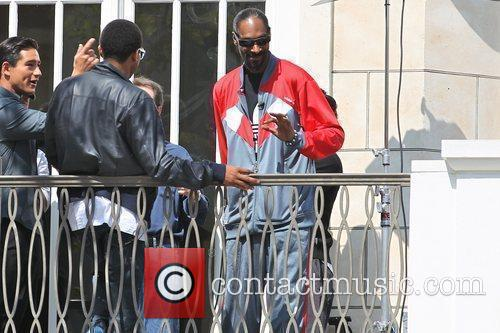 Snoop Dogg filming an interview for the entertainment...