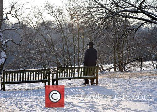 A man takes a walk in the snow...