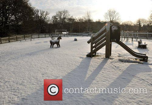 A playground is covered in snow on Hampstead...
