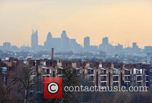 Snow covers the houses near Hampstead Heath with...