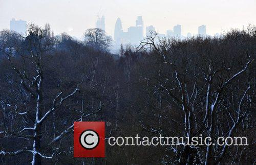 Snow covers the trees on Hampstead Heath with...