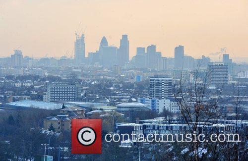 Snow coversthe houses near Hampstead Heath with the...